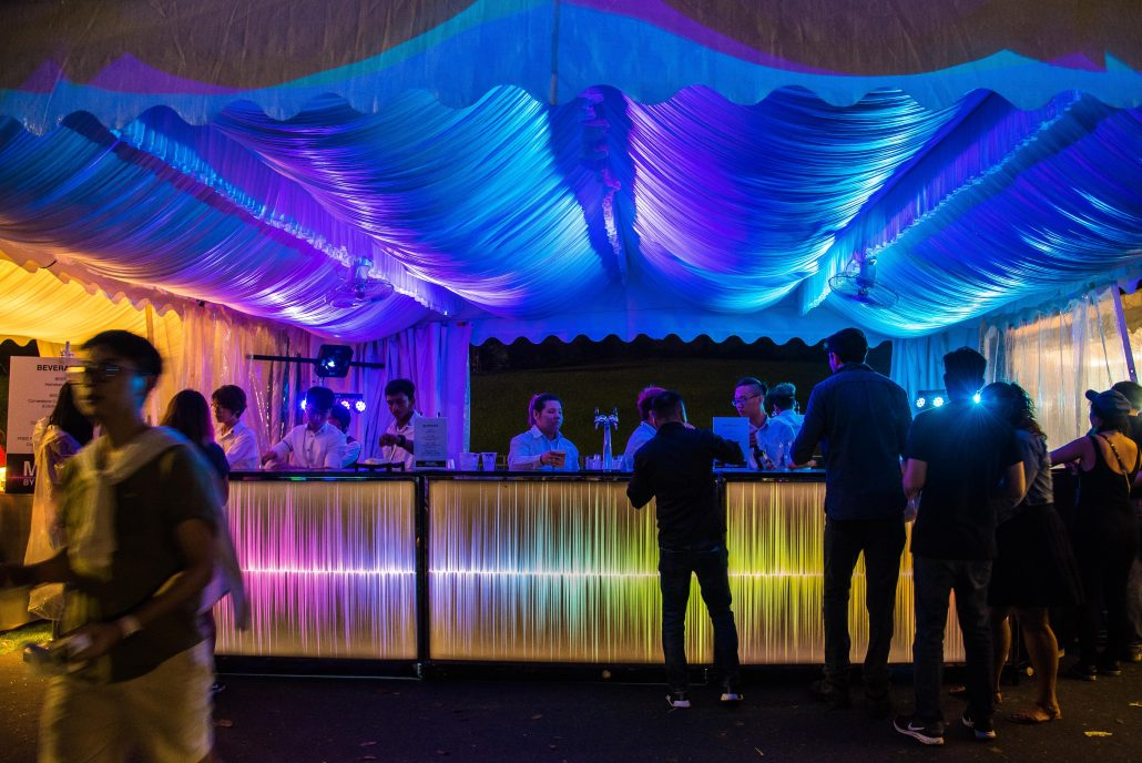 Portable bar lit up with ambient lighting provided by The AVA Club